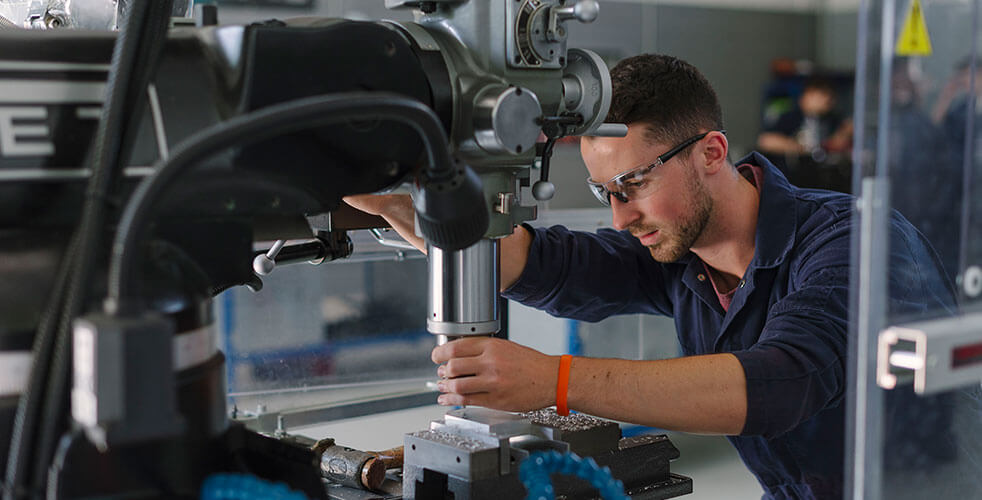 A student using engineering machinery at the Technology Centre