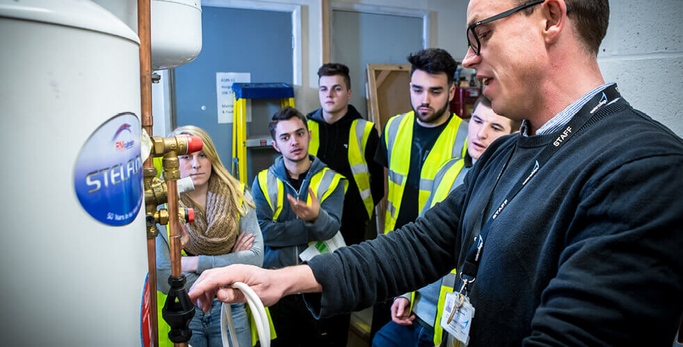 Plumbing Students at Construction Centre