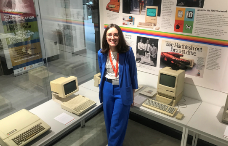 Exeter College student Sophie Bruce poses with old Apple Mac computers at the Mac Museum exhibit, located in the Exeter College Institute of Technology Digital and Data Centre.